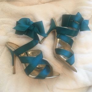 Strappy blue satin bebe heels with gold accents